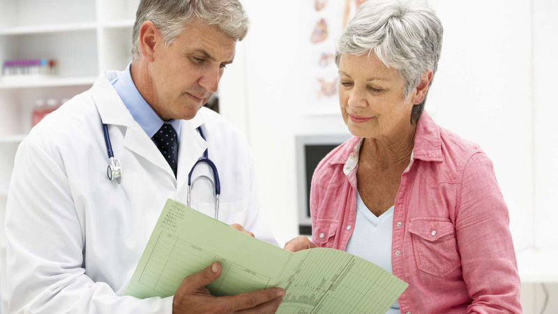 A doctor and patient review test results.