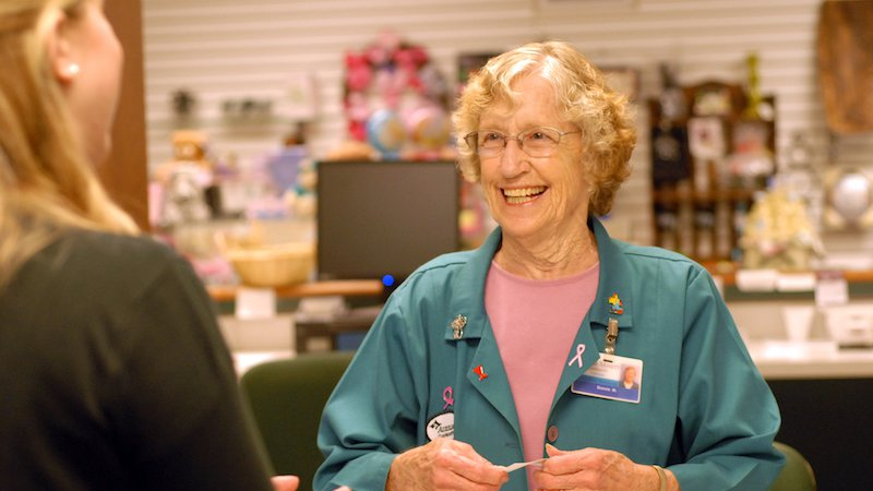 A CoxHealth volunteer helps a customer in the gift shop.